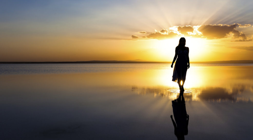 Walking on water at sunset